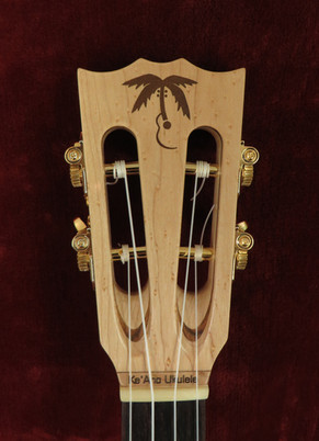Curly Mango Tortuga  Open Headstock.jpg