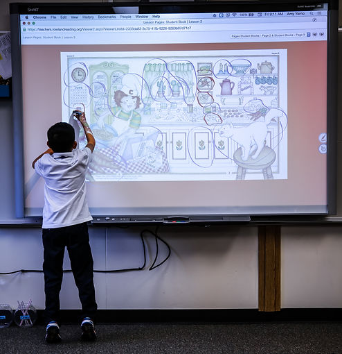 Student using interactive white board by Smartboard.