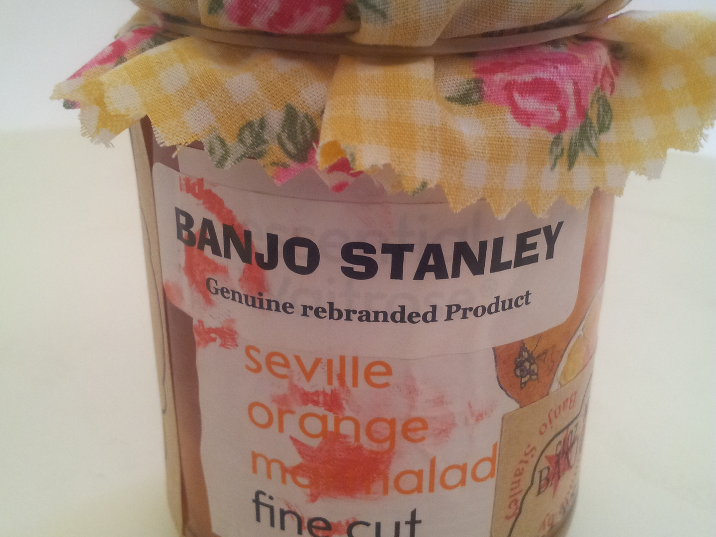 Rebranded Orange Jam, with an added cloth top