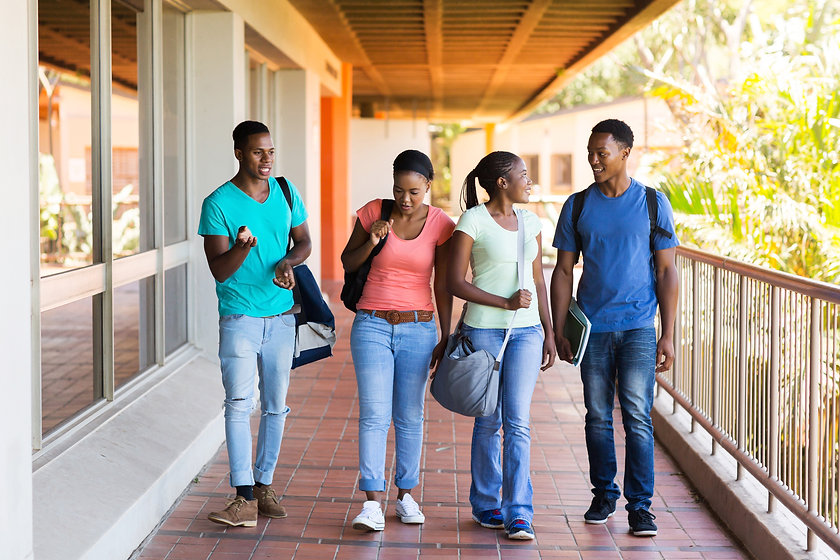 group of smart college students walking