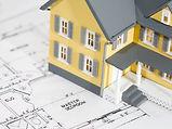 yellow-house-replica-on-top-architectura