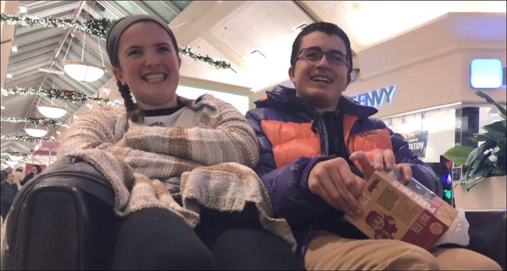 Abby and Sam smiling at the mall.