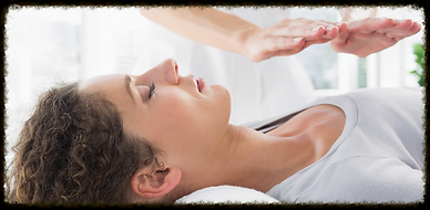 Someone receiving a Reiki healing treatment