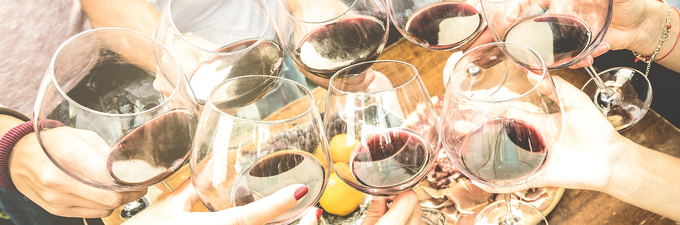 Friends hands toasting red wine glass an