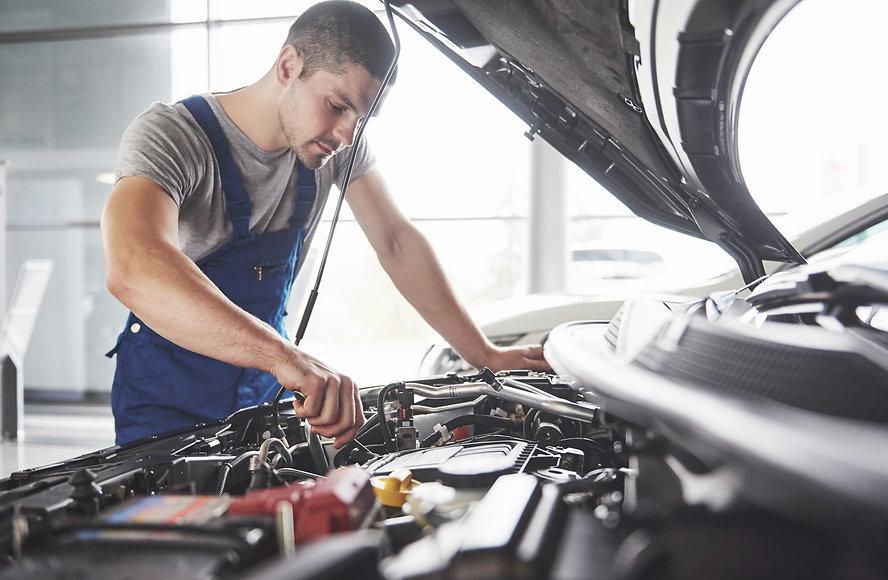 auto-mechanic-working-garage-repair-serv