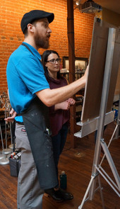 Cody-working-with-Jenn-at-the-easel.jpg