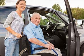Volunteer helping veteran in wheelchair