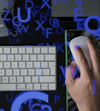 Blue letters are floating above the right side of a computer keyboard.