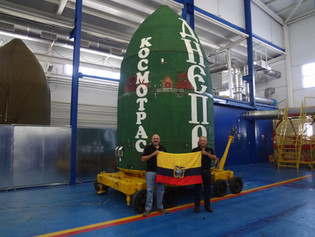 The Ecuadorian flag and the SHM of the Dnepr rocket carrying the NEE-02 KRYSAOR