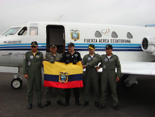 EXA mission commander and his crew in front of the FuerzaG-1 Condor parabollic flight plane