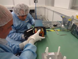 EXA engineers integrating the NEE-01 satellite into the POD