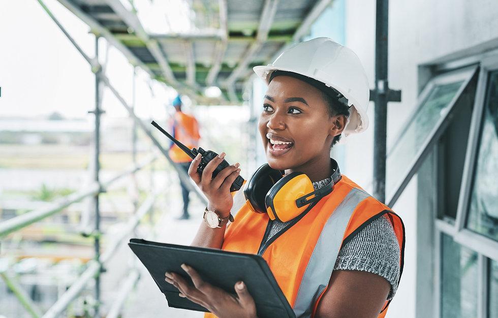 Female construction worker speaking over radio