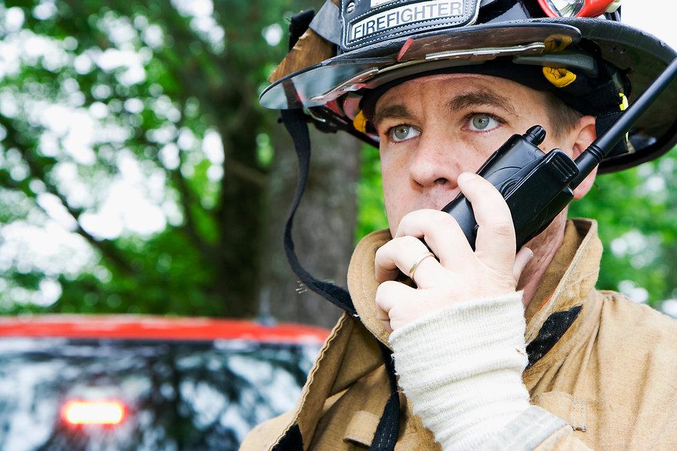 Fireman speaking over radio