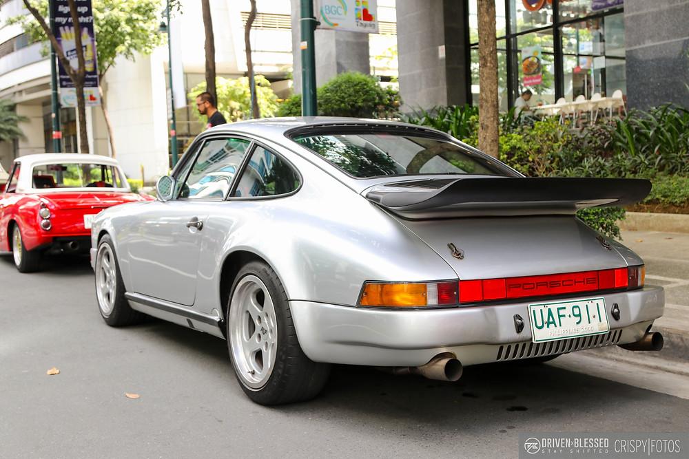 Porsche 911 silver rear driver side profile