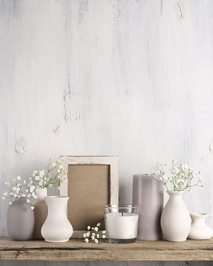 White flowers in neutral colored vases,