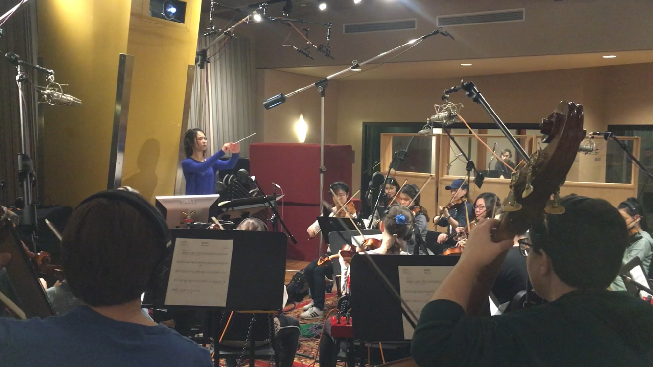 Conducting Original Orchestral Score in Recording Session