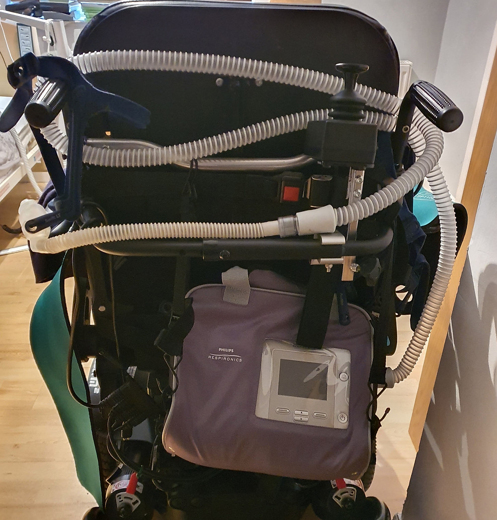 Powered wheelchair with PHILIPS on the back