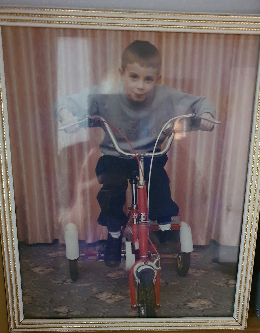 photo of me on a tricycle