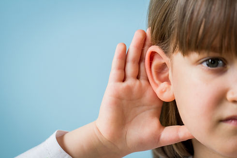 Child with hearing problem on blue backg