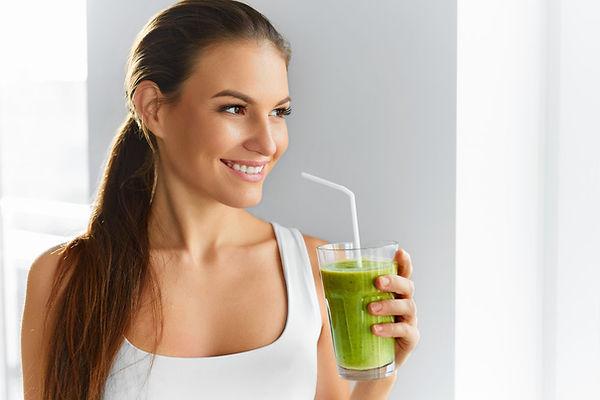 girl wi green drink pic.jpeg