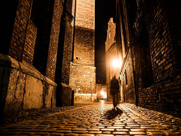 0_Illuminated-cobbled-street-in-old-city