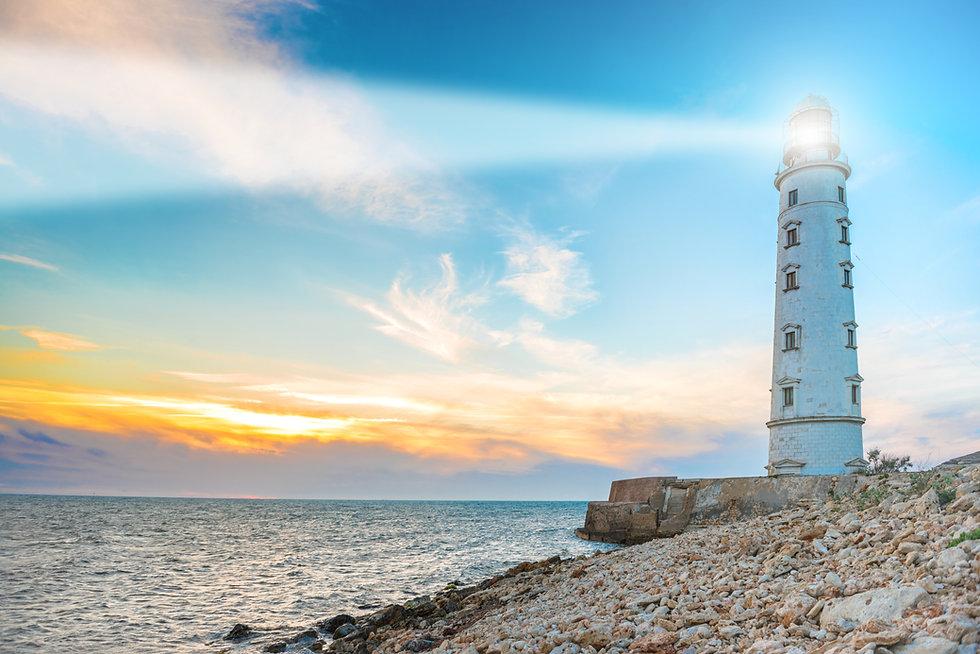 Lighthouse searchlight beam through sea