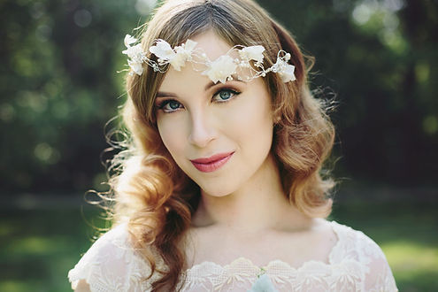 Bride with floral head piece, white dress, soft curls, caucasian bride, wavy hair