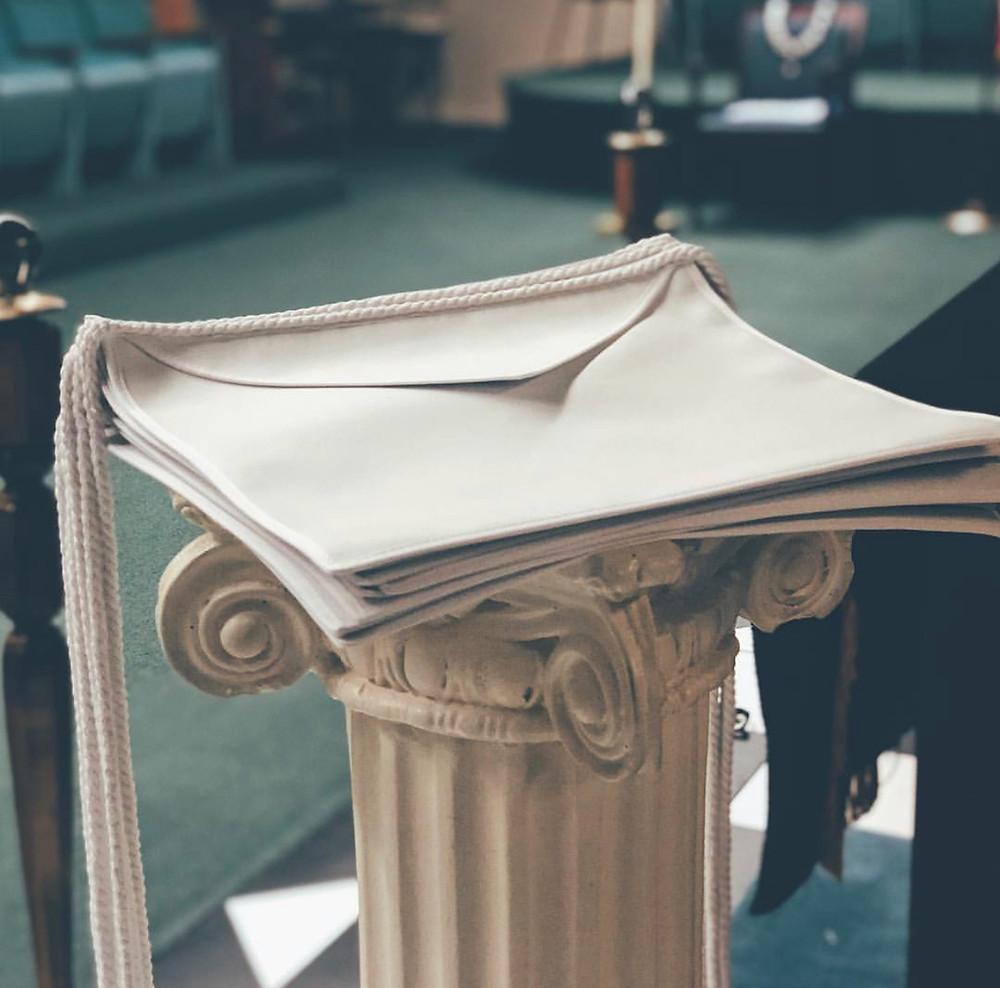 White aprons prepared for presentation