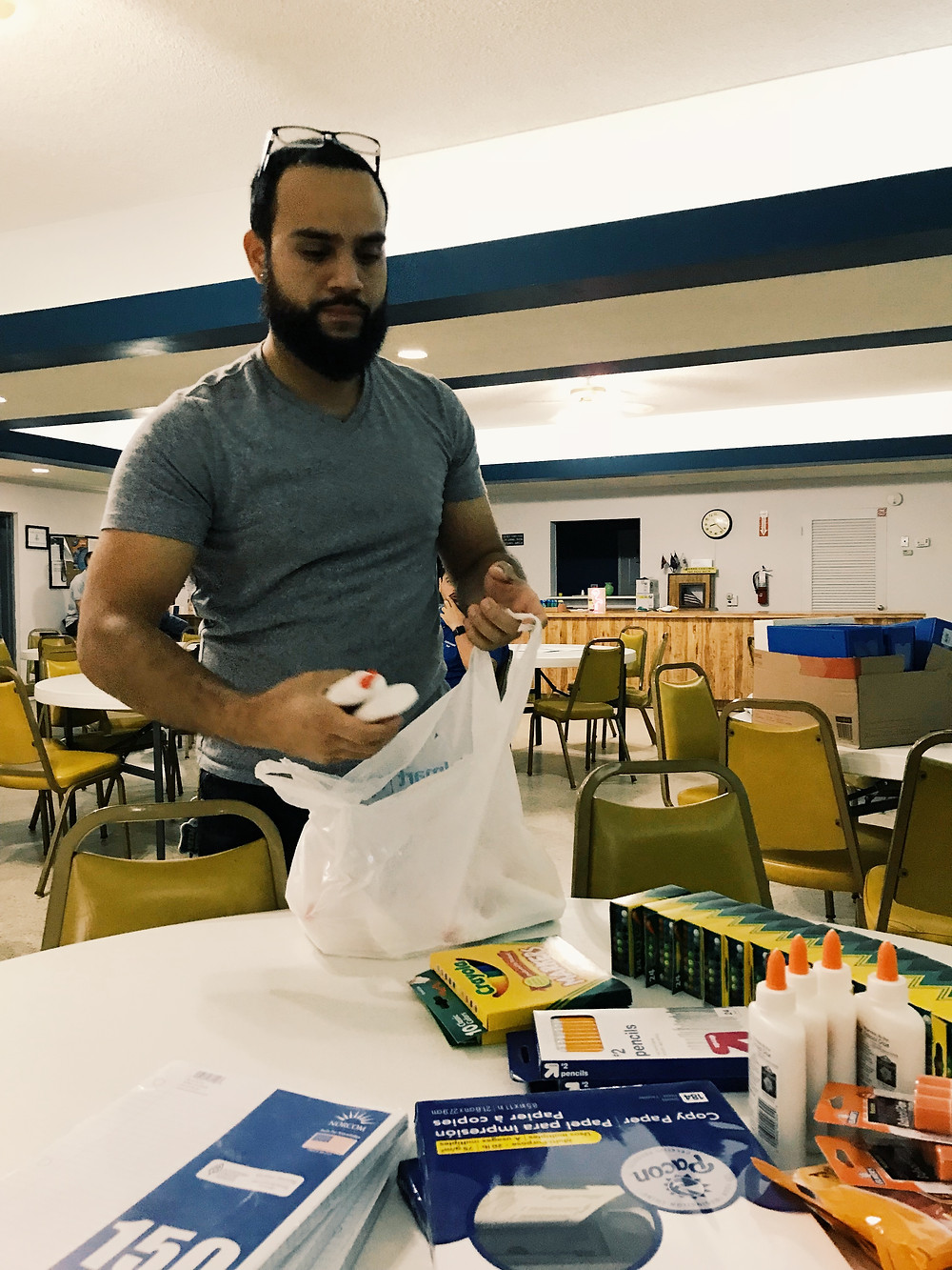 Brother Joshua Smithwong prepares supplies for delivery.