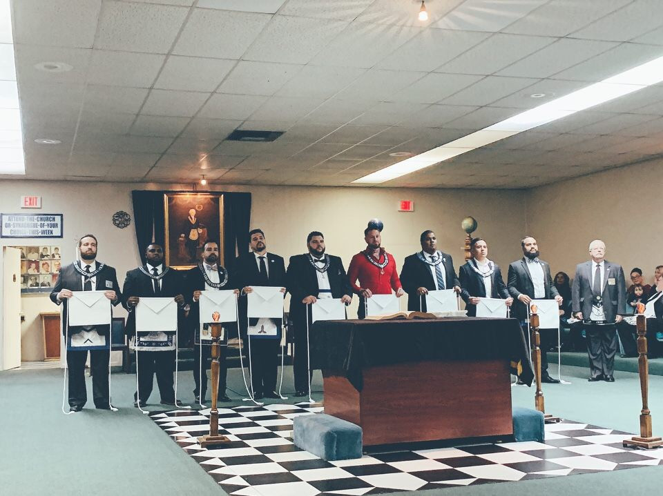 Nine Brother from Hialeah-Opa-Locka Lodge No. 391 receiving their white aprons