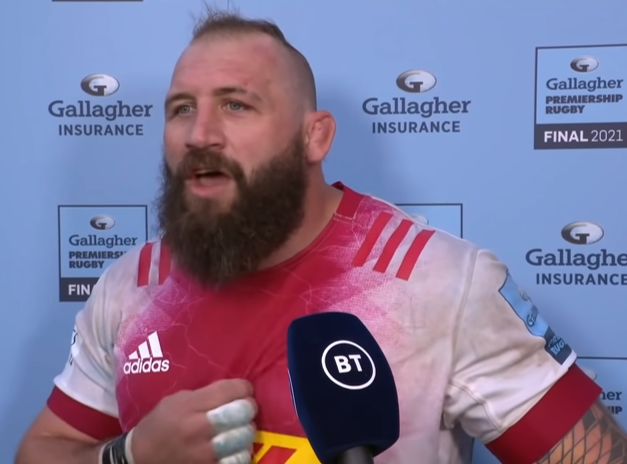 Bearded man in a rugby shirt talks about belief