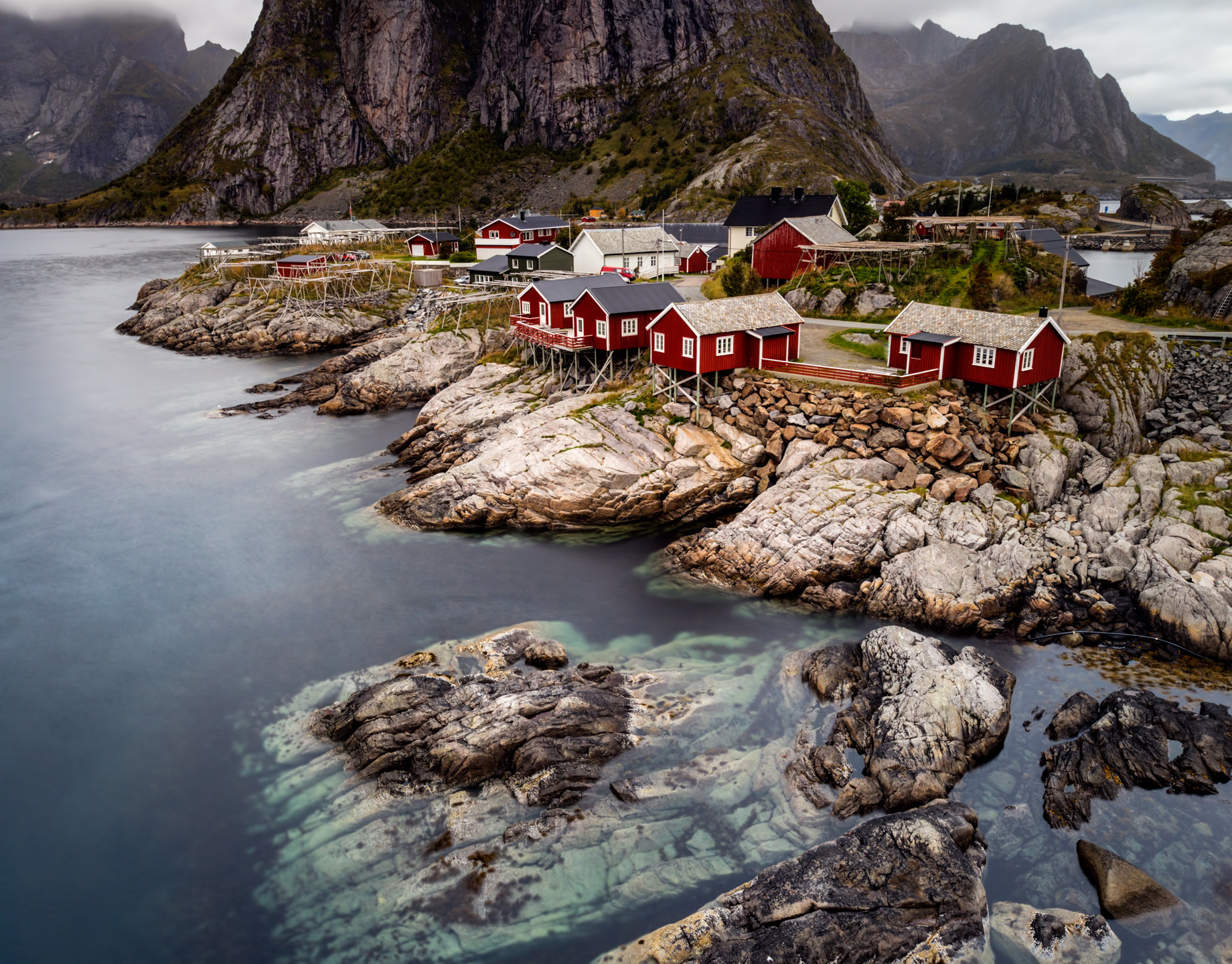 Hamnoy, in the Lofoten Islands Norway, is breathtaking with fishing villages nestled alongside pristine coastlines, all connected by narrow bridges. Behind like giants stand magnificent rugged mountains dominating the landscape creating the most beautiful scenes to capture.  Shot on: Canon 5D Mark IV and Canon 16-35mm f2.8 Mark II lens