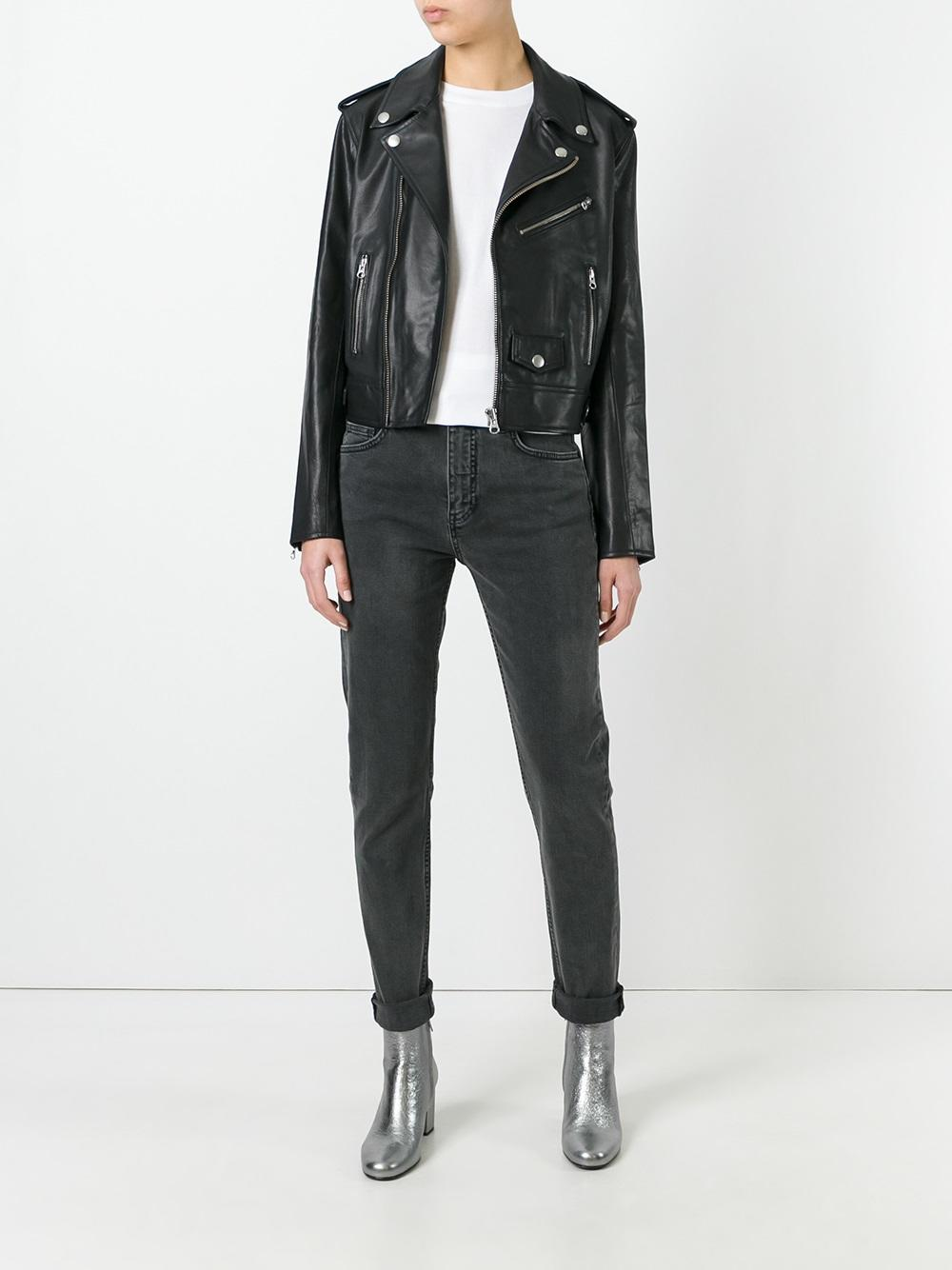 Start with a pair of slim fit black jeans like this pair of Alexander McQueen featuring button fastening, a waistband with belt. loops, a five pocket design and a regular length. $245