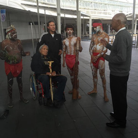 Indigenous Welcome Ceremony for Rick Mora and Elder Saginaw Grant at Sydney International Airport wi
