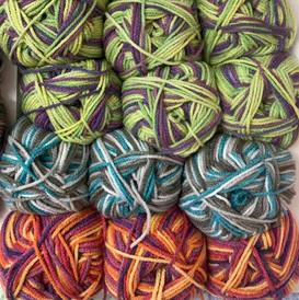 Rambler-aran-woolcraft-green-red-turquoise-wool-yarn.jpg