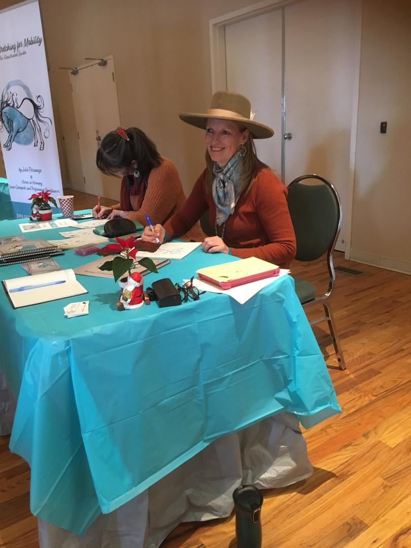 Julie signing book