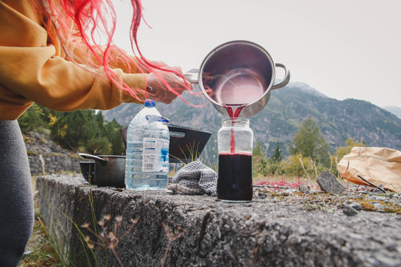 Elderberry cordial cooked on the fire in the Alps