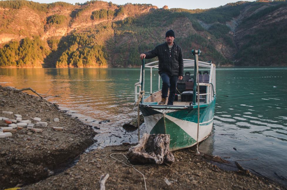 Documentary project, captain of the boat on Lake Koman - From Rust To Roadtrip