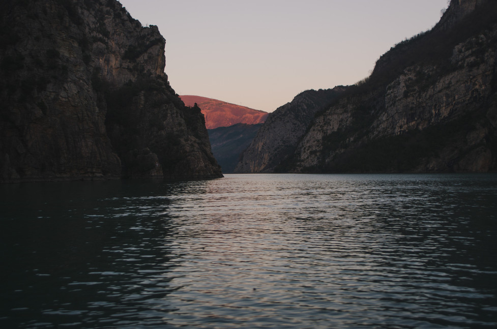 Sunset in the mountains of Albania, Lake Koman - From Rust To Roadtrip