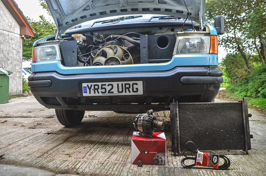 The radiator, alternatr and fan belt being repaired on our LDV Convoy