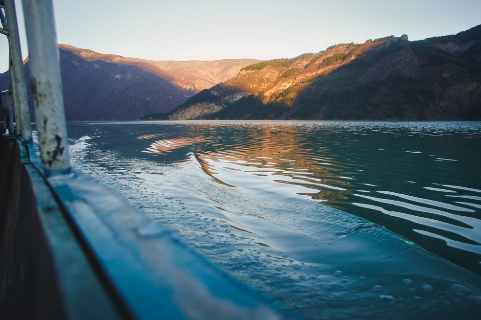 Boat ride at sunset across Lake Koman in the Albanian Alps - From Rust To Roadtrip