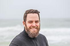 man-wearing-black-zip-up-jacket-near-beach-smiling-at-the-736716_edited.jpg