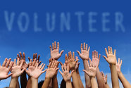 Hands in the sky toward a sky sign for the word volunteer - links to WHUT Volunteer Page.jpg