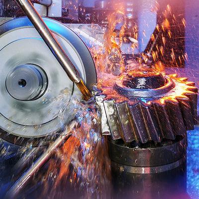 Grinding machine, grinding a gear wheel