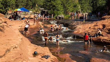 people playing at slide rock