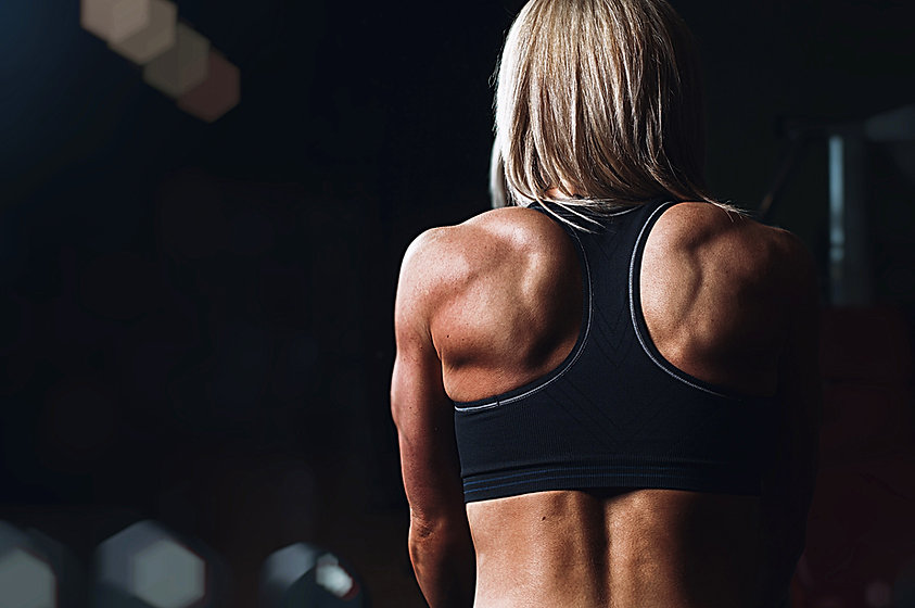 Fit woman with strong back muscles