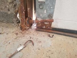 rusted garage door hinge-min.jpg