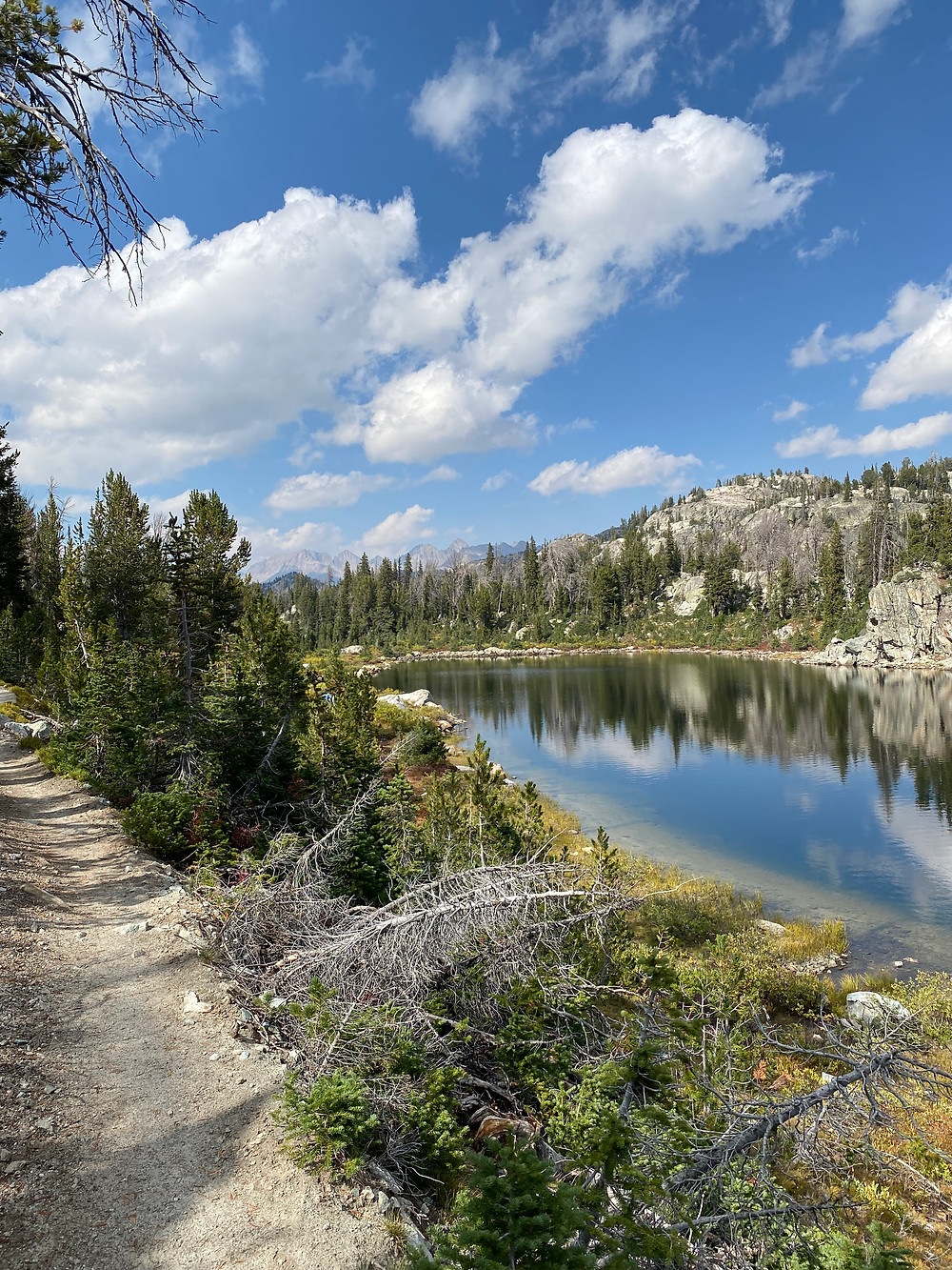 Hobbs Lake is another crystal clear perfectly reflective body of water in Bridger-Teton National Forest in Wyoming