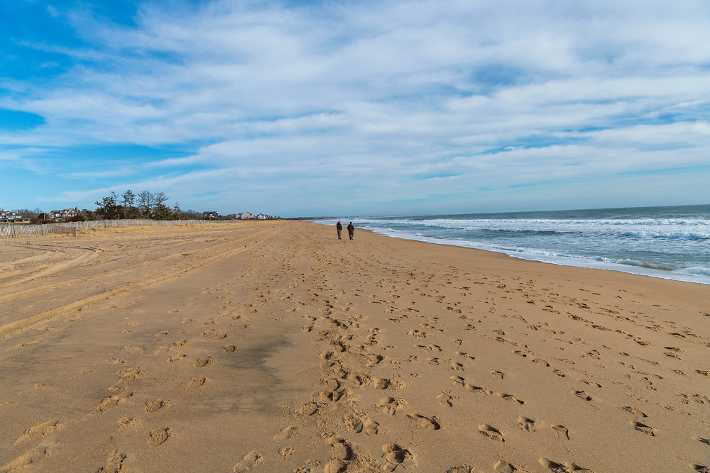 A sandy beach full of memories of poor adolescent decision making stretches for miles. Probably Taylor Swift and one of her friends are walking along the shoreline.Watch Hill Beach in WEsterly, Rhode Island