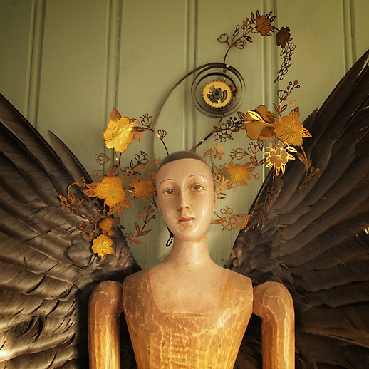 My Renaissance-Angel. Made of Wood, Crow-wings and stansed Metal pieces.